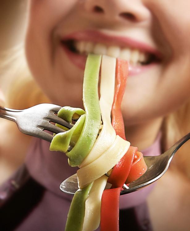 Woman eating pasta close up shoot